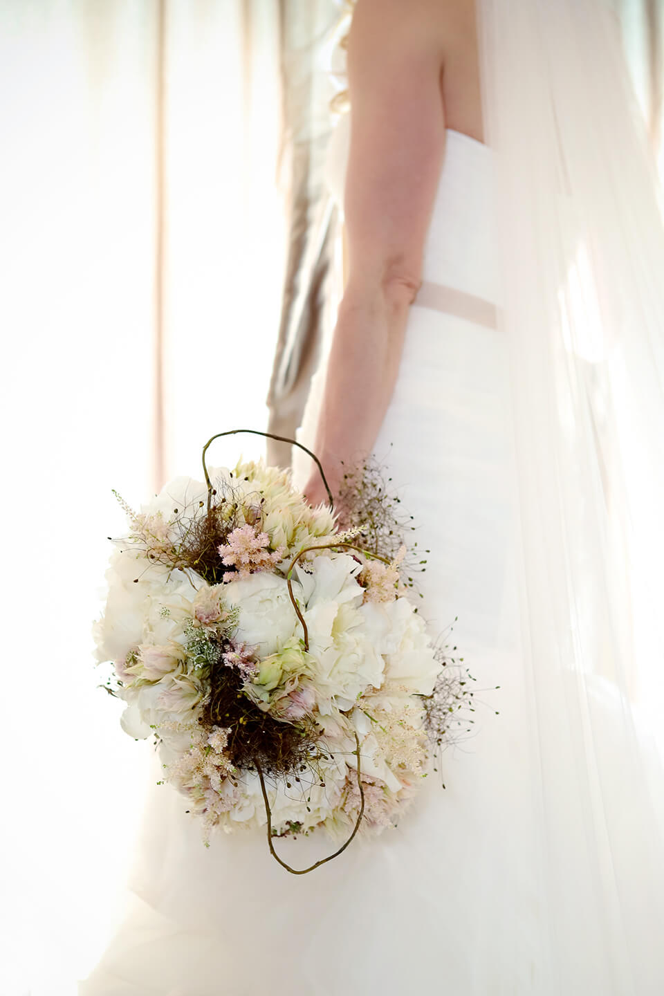 Bride with bouquet.